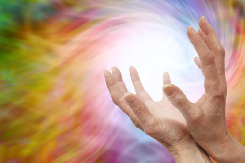 hands holding a ball of energy